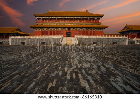 Sunrise at a building adjacent the Hall of Supreme Harmony in the Forbidden City, Imperial Palace complex in Beijing, China - stock photo