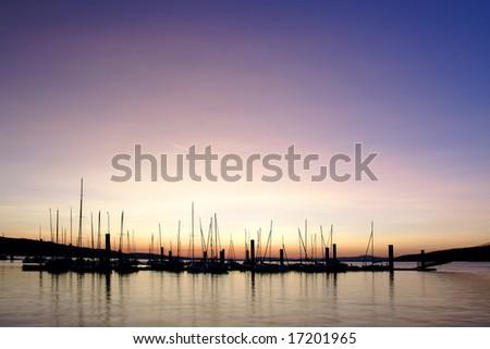 Sunrise at deserted pier - stock photo
