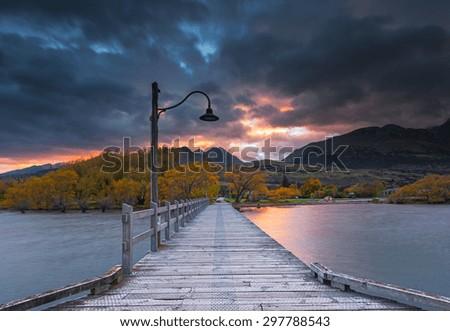 Sunrise at Glenorchy jetty, New Zealand. Smooth water on lake Wakatipu - stock photo