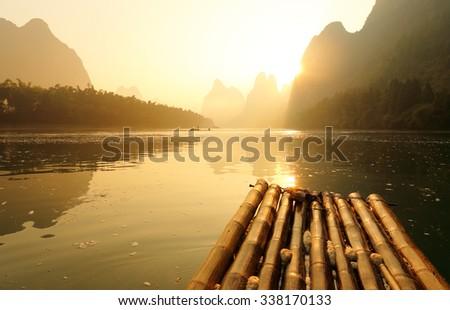 Sunrise at Huangbu (Yellow Cloth) Beach along Li River, Xingping, Yangshuo, China. Xingping is a town in North Guangxi, China. It is 27 kilometers upstream from Yangshuo on the Li River - stock photo