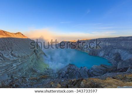 Sunrise at Kawah Ijen Volcano, East Java island, Indonesia - stock photo