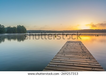 "sunrise at lake ""Schwarzer See""/""Mecklenburgische Seenplatte"" in Germany - stock photo"