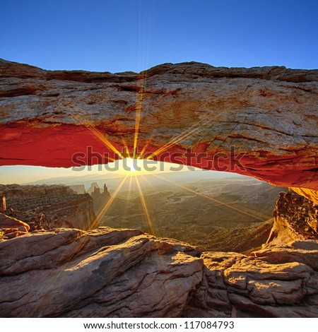 Sunrise at Mesa Arch in Canyonlands National Park, Utah, USA - stock photo