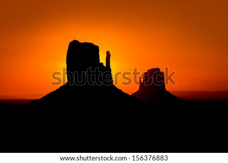 Sunrise at Monument Valley West and East Mittens Butte Utah National Park - stock photo