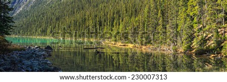 Sunrise at Mount Edith Cavell from the Cavell Lake, Jasper National Park, Alberta, Canada - stock photo
