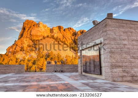 Sunrise at Mount Rushmore National Memorial Monument in the Black Hills of South Dakota, USA. This is a HDR image with blue sky and clouds. / Sunrise at Mount Rushmore. - stock photo