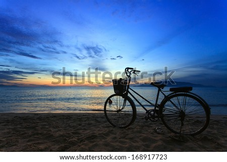 Sunrise at Nha Trang beach, Khanh Hoa Province, Vietnam. Nha Trang is well known for its beaches and scuba diving and has developed into a destination for international tourists. - stock photo