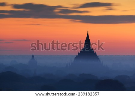 Sunrise at pagoda temples with fog of Bagan, Myanmar - stock photo