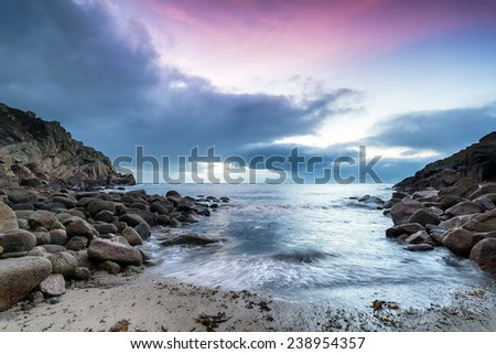 Sunrise at Penberth Cove a small beach near Land's End in Cornwall - stock photo