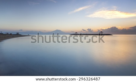 Sunrise at Sanur Beach, Indonesia. Mount Agung clearly visible at the background. - stock photo