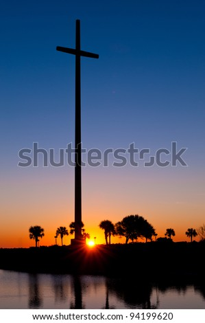 Sunrise at the Great Cross at the Mission of Nombre de Dios in St. Augustine, Florida - stock photo