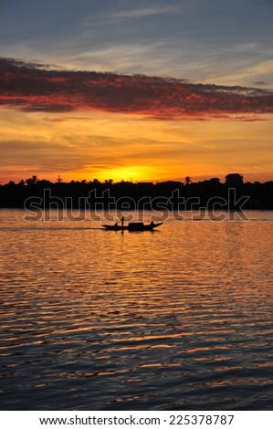 sunrise at vietnam river - stock photo