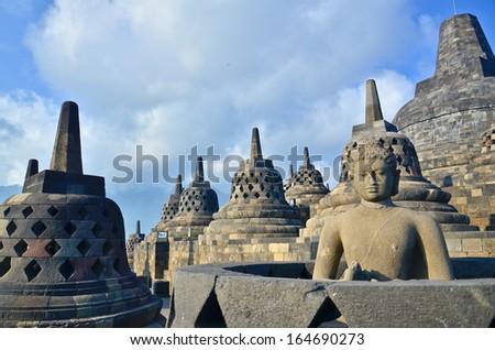 Sunrise Borobudur Temple Stupa in Yogyakarta, Java, Indonesia. - stock photo