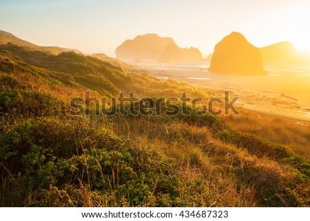 Sunrise by the sea stacks of the Oregon coast - stock photo