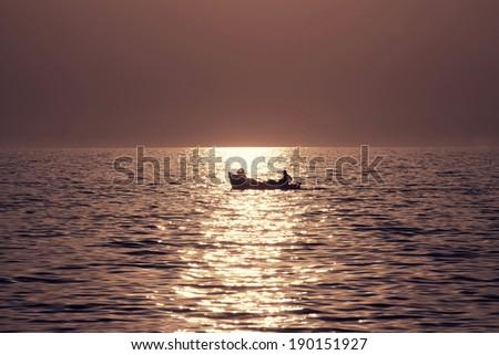 Sunrise Fisherman Silhouette - stock photo