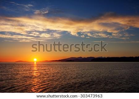 Sunrise from afar - stock photo