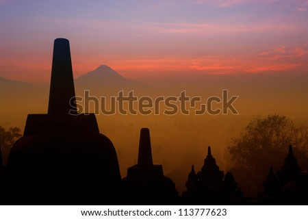 Sunrise from Borobudur Temple with Mount Merapi in the background - stock photo
