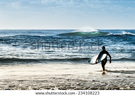 Sunrise image of surfers at the beach, Surfers Paradise, Gold Coast, Australia. - stock photo