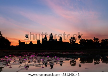 Sunrise in Angkor Wat, a temple complex in Cambodia and the largest religious monument in the world. UNESCO World Heritage Site. - stock photo