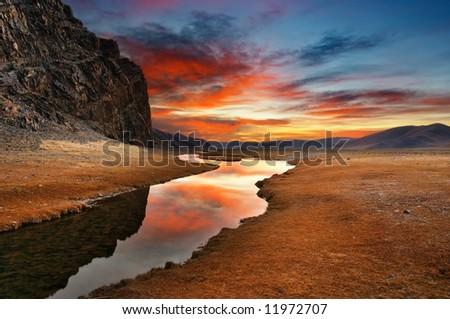 Sunrise in mongolian desert - stock photo