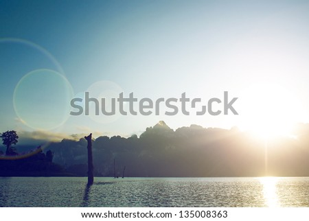 sunrise in mountains at  beautiful lake in  reserve , sun beams in shot . Thailand - stock photo