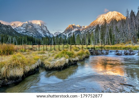 Sunrise in the Idaho mountains and beaver dam - stock photo