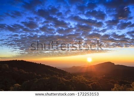 Sunrise mist mountain winter landscape. - stock photo