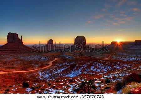 Sunrise Monument Valley Arizona site of many cowboy western movies  - stock photo