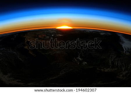 Sunrise of the Earth. Elements of this image furnished by NASA. - stock photo