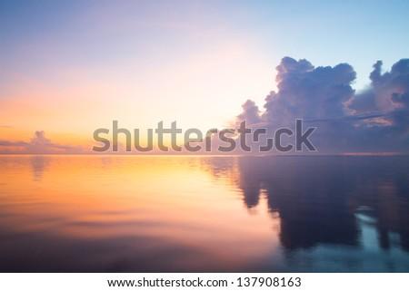 sunrise of the peaceful ocean - stock photo