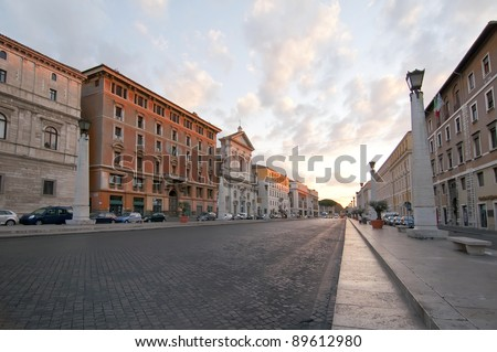 Sunrise on a street without people in the city of Rome, Italy - stock photo