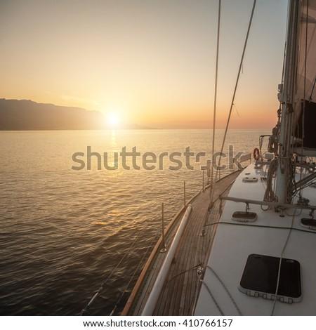 Sunrise on a yacht at sea. - stock photo