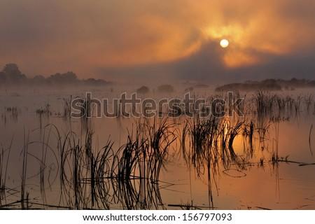 sunrise on autumn lake - stock photo