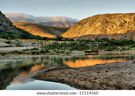 Sunrise on awesome river in mountains. Shot in the Langeberge highlands near Grootrivier and Gouritsrivier rivers crossing, Garden Route, Western Cape, South Africa. - stock photo