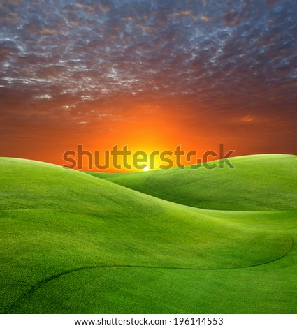 sunrise on golf field - stock photo