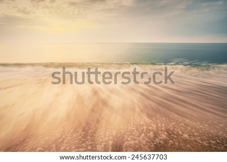 sunrise on ocean beach, abstract vintage summer background - stock photo