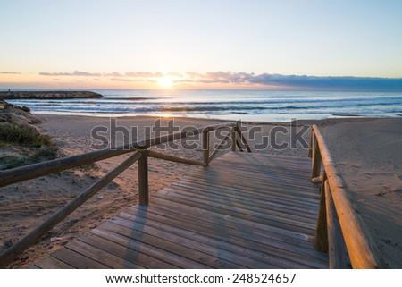 Sunrise on scenic Guardamar beach, Costa Blanca, Spain - stock photo