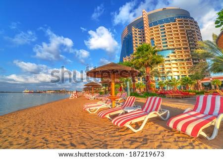 Sunrise on the beach at Perian Gulf in Abu Dhabi - stock photo