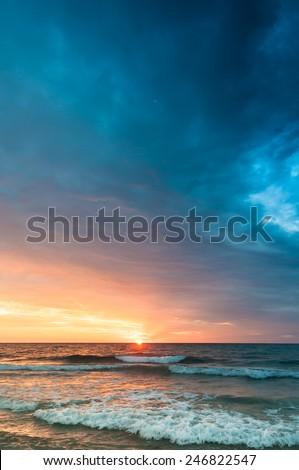 Sunrise on the beach of Cala Millor - stock photo