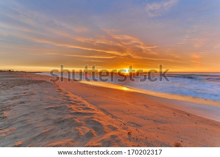 Sunrise on the beach on a winter day in Barcelona - stock photo