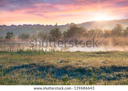 Sunrise on the outskirts of the city - stock photo