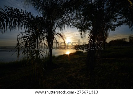 Sunrise on the Pond - Lagoa Santa, Minas Gerais, Brazil - stock photo