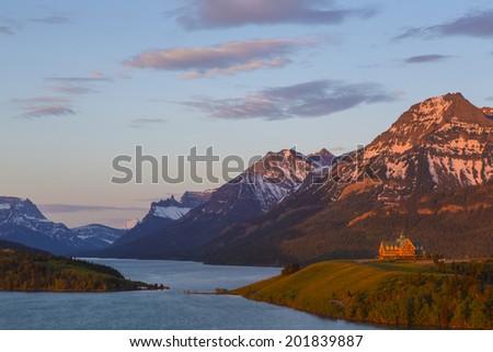 Sunrise on the Prince of Wales Hotel, Waterton Lakes Village, Waterton Lakes National Park, Alberta, Canada - stock photo