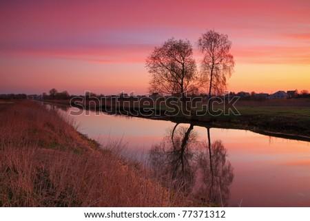 Sunrise on the river - stock photo