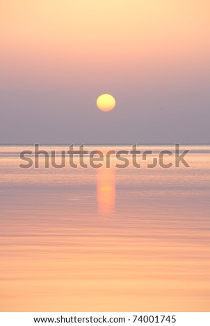 Sunrise on the sea, very calm weather - stock photo