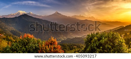 Sunrise over Annapurna. Annapurna is a collection of mountains in the Himalayas near Pokhara in Nepal - stock photo