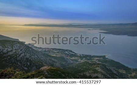 Sunrise over Dalmatia, a morning drive and hike to Vidova gora (780m/2.560ft), island of Brac, Croatia, resulted in a beautiful sunrise, overlooking the majestic archipelago of central Dalmatia. - stock photo