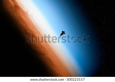 Sunrise over earth's horizon. Digital illustration. Space shuttle furnished by NASA. - stock photo