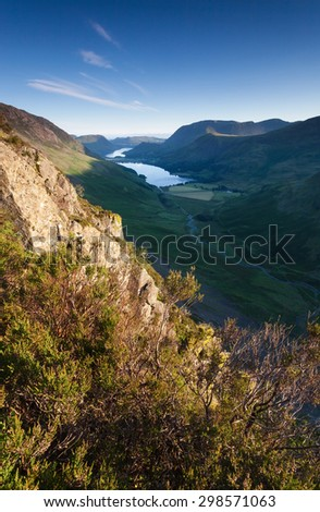 Sunrise over Lake Buttermere from the summit of Haystacks in the Lake District. - stock photo