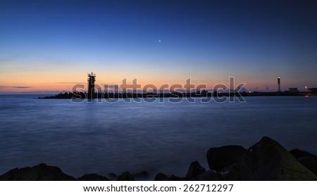 Sunrise over lighthouse,Beautiful seascape - stock photo